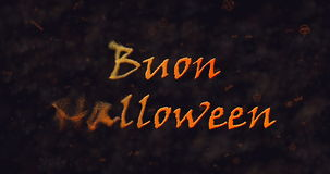 Buon Halloween text in Italian dissolving into dust to left Royalty Free Stock Image