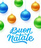 Buon Natale background with blue Christmas balls. Buon Natale italian Merry Christmas text and colorful hanging balls  on white background. Greeting card design Stock Photos