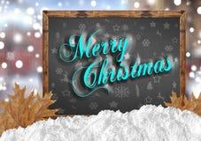 Buon Natale blu sulla lavagna con le foglie e la neve della città Immagini Stock