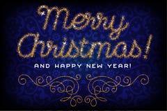 Buon Natale che segna la fonte con lettere di scintillio dell'oro Immagine Stock