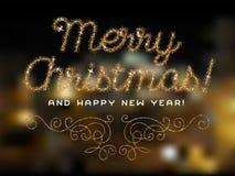 Buon Natale che segna la fonte con lettere di scintillio dell'oro Fotografia Stock