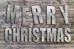 Buon Natale del ferro scritto sul bordo di legno Fotografia Stock Libera da Diritti