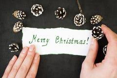 Buon Natale di congratulazioni dell'iscrizione su Libro Bianco Fotografia Stock