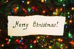 Buon Natale di congratulazioni dell'iscrizione sull'Natale garlan Immagini Stock Libere da Diritti