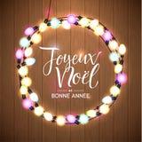 Buon Natale e buon anno Lingua francese Corona d'ardore delle luci di Natale per progettazione della cartolina d'auguri di festa  Fotografia Stock