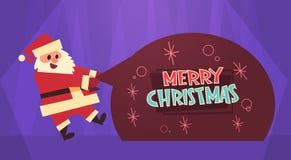 Buon Natale ed insegna di concetto di vacanze invernali di Santa Holding Big Present Sack della cartolina d'auguri del buon anno Immagini Stock
