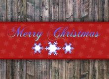 Buon Natale scritto sul bordo di legno con il fiocco di neve Fotografie Stock Libere da Diritti