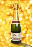 Buon Natale su un'etichetta di una bottiglia di Champagne Immagine Stock Libera da Diritti