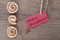 Buon Natale su un'etichetta rossa Fotografie Stock