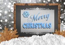Buon Natale sulla lavagna con le foglie e la neve della foresta Fotografia Stock
