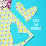 Buon san valentine, happy valentine day in Italian. A heart cut out from a colorful abstract-patterned paper and the text buon san valentino, happy valentines Stock Image