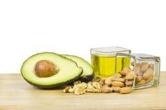 Buona dieta dei grassi (avocado, frutti asciutti ed olio) Immagini Stock Libere da Diritti