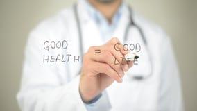 Buona salute, buona vita, scrittura di medico sullo schermo trasparente fotografia stock libera da diritti