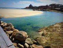 Buona spiaggia del porto Fotografia Stock