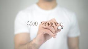 Buongiorno, scrittura dell'uomo sullo schermo trasparente Fotografie Stock