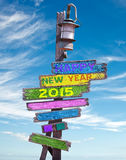 2015 buoni anni sui segnali di direzione di legno Fotografia Stock Libera da Diritti