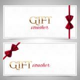 Buoni di regalo di vettore con gli archi rossi Fotografie Stock