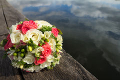 Buoquet of roses. Water and wood Royalty Free Stock Photography