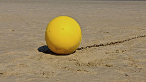 Buoy. A lonely yellow buoy on the beach Stock Photos