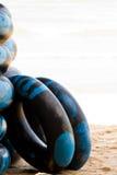Buoy. Group black life buoy on beach stock images