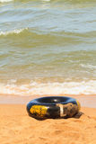 Buoy. Black life buoy on beach stock image