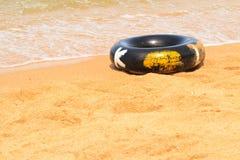 Buoy. Black life buoy on beach royalty free stock image