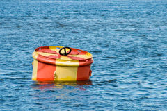 Buoy. On a surface of water stock photography