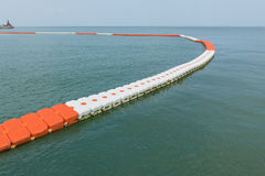 Buoy barrier on sea surface to protect people from boat.  royalty free stock images