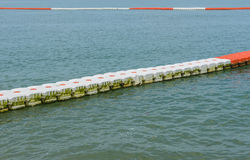 buoy barrier on sea surface to protect people from boat Stock Photography