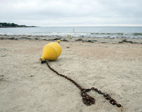 Buoy on the beach Stock Photography
