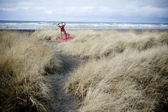 Buoy on the beach. Red bouy sitting on the beach with tall grass in the foreground Stock Images