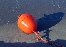 Buoy on a beach during low tide. Red buoy on a beach during low tide Stock Photo