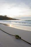 Buoy on the beach when sun rise Royalty Free Stock Photos