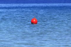 Buoy at blue ocean like emergency sign for sailing boat Royalty Free Stock Image