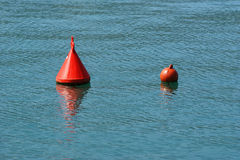 Buoy in the blue sea Royalty Free Stock Photo