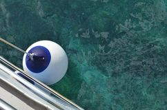 Buoy on a boat above cyan and blue ocean. In Istria in Croatia during a trip stock image