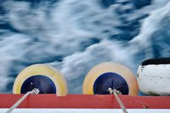 Buoy on body of moving ship royalty free stock photography