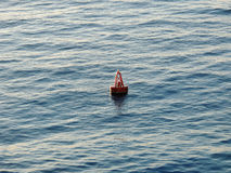 Buoy Floating in the Ocean Royalty Free Stock Image