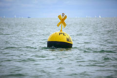Buoy floating at sea Royalty Free Stock Image