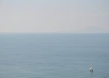 Buoy floating on the vast sea Royalty Free Stock Image