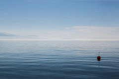 Buoy floats on Lake Geneva Stock Photos