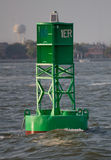 Buoy. Green buoy in foreground provides guidance Stock Photo