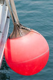 Buoy hanging on the aboard of fishing boat. Royalty Free Stock Photography
