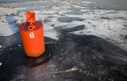 Buoy on ice Royalty Free Stock Image