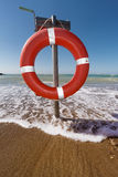 Buoy life saver on the beach Stock Photography