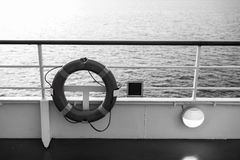 Buoy or lifebuoy ring on shipboard in evening sea in miami, usa. Flotation device on ship side on seascape. Safety. Rescue, life preserver. Water travel royalty free stock images