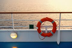 Buoy or lifebuoy ring on shipboard in evening sea in miami, usa. Flotation device on ship side on seascape. Safety. Rescue, life preserver. Water travel stock photos