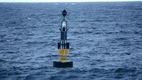 Buoy in the middle of the sea stock video footage