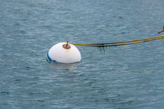 Buoy in ocean. Attached by rope Royalty Free Stock Photos