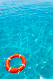 Buoy orange floating in perfect tropical beach Stock Image